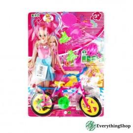 Игрушка - кукла с велосипедом